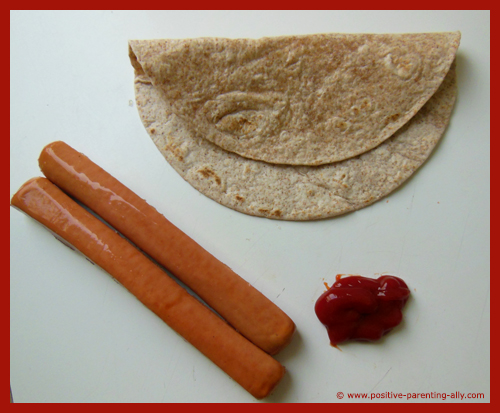 Ingredients for Halloween fingers: tortilla, sausages and ketchup