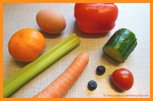 Ingredients for making funny veggie and fruit face on a plate.