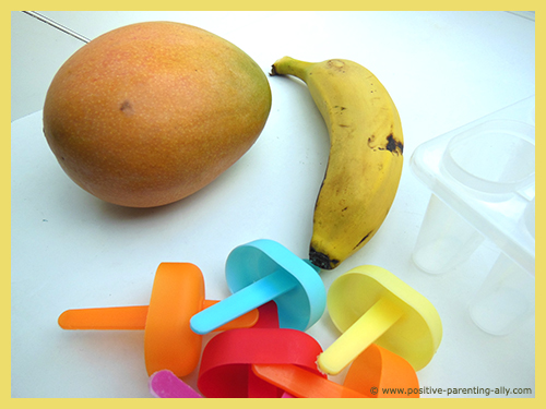 Ingredients for delicious mango banana pure fruit popsicles for kids.