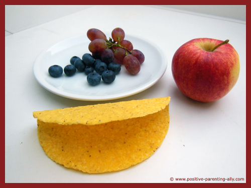 Ingredients for the fruit tortilla: tortilla shell, apple, blueberries and grapes.