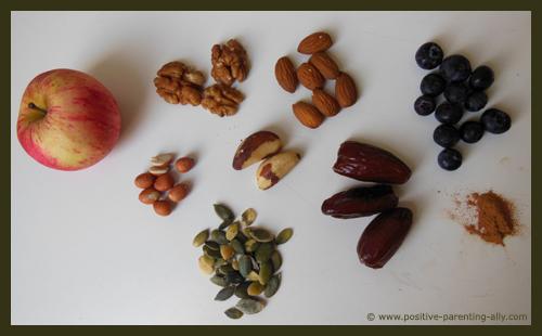 Ingredients for healthy Halloween snacks: nuts, berries, seeds, apple