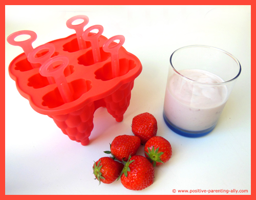 Ingredients for homemade yogurt strawberry icecream with real strawberry pieces.