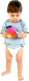 Little toddler girl in diapers holding a soft ball.