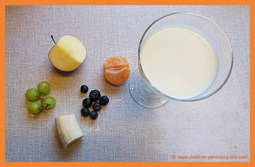 Ingredients for a simple milk and fruit snack for kids.