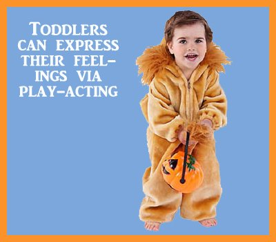 Toddler play acting. Little girl dressed up as a lion.