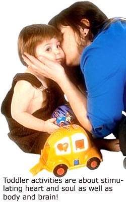 Showing love and affection are also important toddler learning games: Mother kissing her little boy.