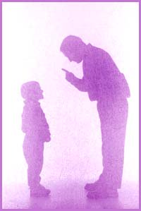 Silhouette of father disciplining his son.