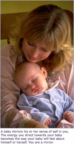 Cute picture of mom holding sleeping baby