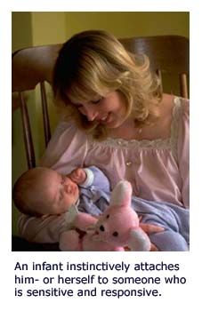 Attachment theory - mom holding sleeping child
