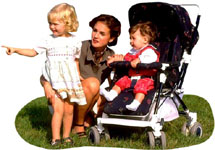Authoritative parenting: Mother kneening next to little girl and little boy in pram.