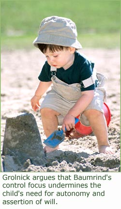 Authoritative Parenting Style: Little boy playing in the sand on the beach!