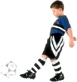 Little boy hitting a football. Playing soccer.