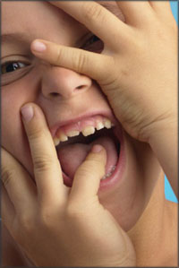 Close up of boy laughing.