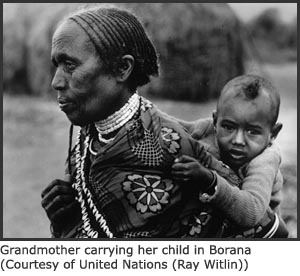 Photo of Ethiopian grandmother carrying baby