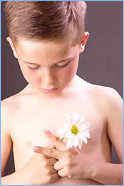 Healthy Parenting: Little boy holding a flower in his hands.