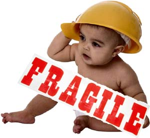 Helicopter Parents And Overparenting Truths And Traits Image Of Baby In Safety Helmet And Fragile Sign