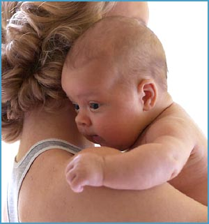 High need baby: picture of skin to skin contack between mother and baby. Mother carrying baby over her shoulder!