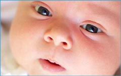 High need baby: picture of baby's face. Looking into baby's eyes.
