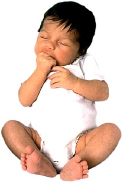 Sleeping infant sucking on hand. Newborn development insights.