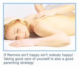 Mommy relaxing with a nice massage. Picture of woman getting her back rubbed