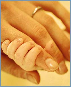 Parenting style: Baby hand holding mother's finger.