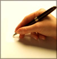 Parenting style quiz: Hand with a pencil writing on paper.