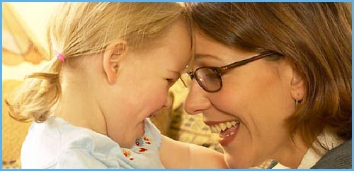 Use the power of the mirror effect in parenting. Photo of mother and daughter looking at each other and laughing!