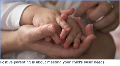 Positive parenting: beautiful picture of baby hands and mother's hand folding in lap.