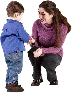 Self esteem activities: mother getting down on her knees to talk to her toddler boy.