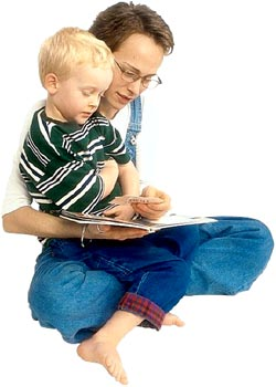 Picture of mom reading out loud with her child.