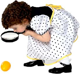 Types of parenting styles: Little girl with magnigfying glass.