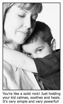 10 parenting tips. Use the power of you body in you parenting. Picture of a mother holding her young boy in her arms comforting him.