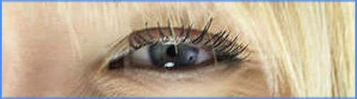 Picture of blond woman with blue eyes. Close up of eye.