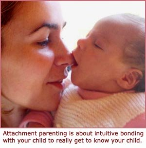 Attachment parenting - cute baby picture - baby sucking on mom's nose