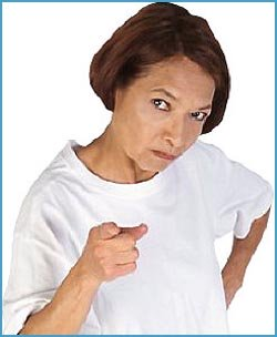 Angry woman scolding with pointing finger.