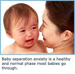 Baby separation anxiety - child crying on shoulder - photo by photorack.net