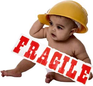 Image of baby in safety helmet and fragile sign.