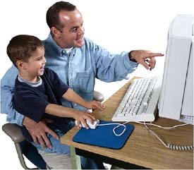 Father and son playing at or working by the computer.