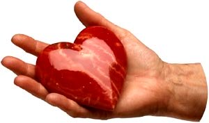 Male hand hand holding red glass heart.