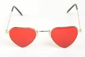 Looking at your child with positive parenting sunglasses. Funny sunglasses with heart shaped red glass