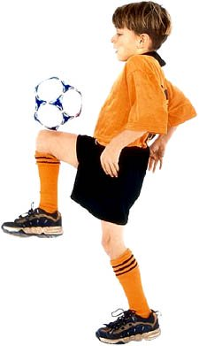 Boy practicing juggling with soccer ball.