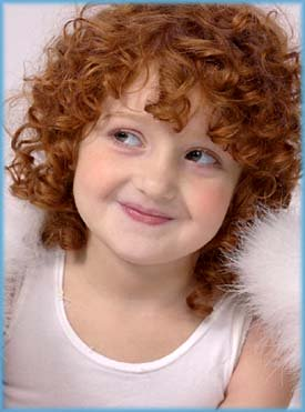Sweet picture of happy redhaired girl.