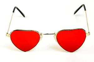 Unconditional parenting: Sunglasses with read heart shaped glass.