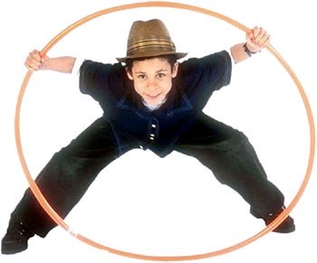 Picture of boy looking throug a hula hoop ring.