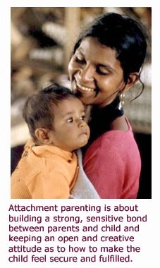 What is attachment parenting - child secure and happy in moms arms